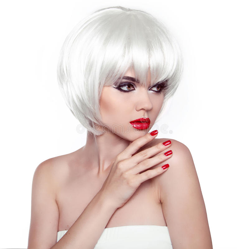 Red lips and manicured nails. Fashion Stylish Beauty Woman Portrait with White Short Hair. Vogue Style Woman. Hairstyle. royalty free stock image