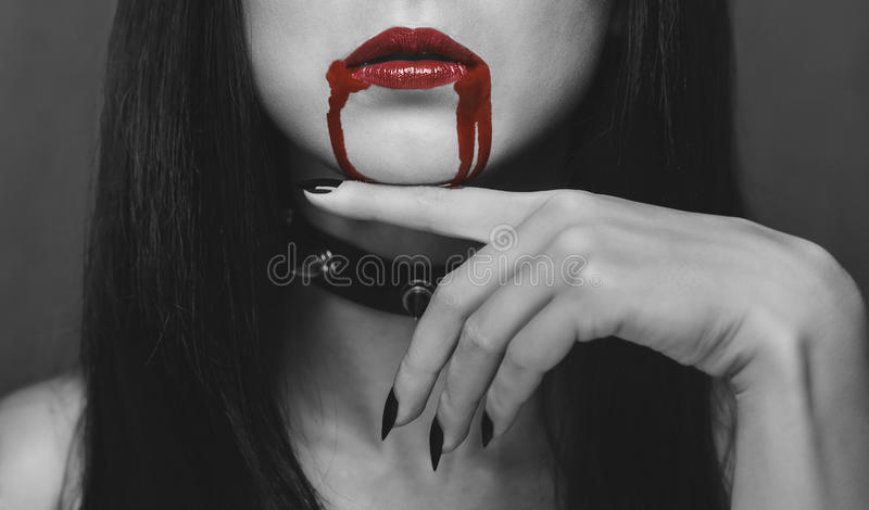 Red lips of vampire in the blood stock photos