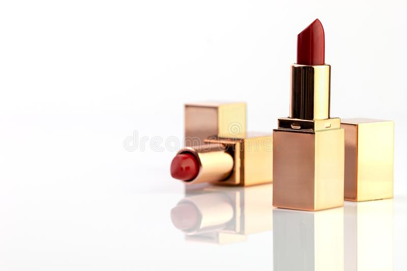 Red lipstick in golden box. royalty free stock photo