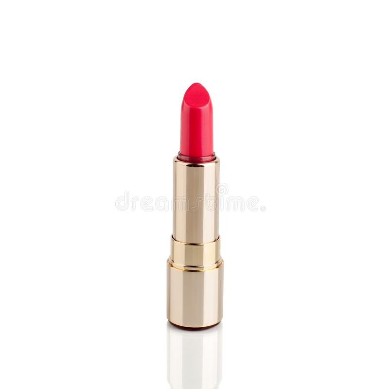 Red lipstick in golden tube on white background with mirror reflection on glass surface isolated close up, open pink lipstick stock photos