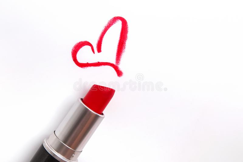 Red lipstick and heart shaped trace isolated on white. Background royalty free stock photo