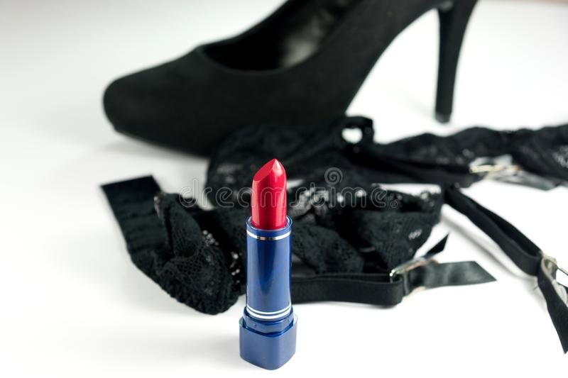 Lipstick, lingerie and a high heel. Red lipstick, lingerie and a high heel royalty free stock image