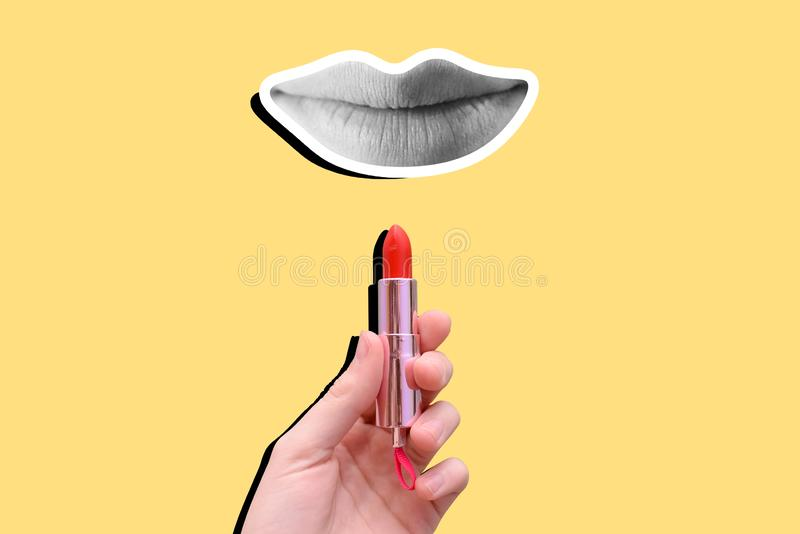 Red lipstick and lips on a yellow background. Contemporary art, collage. Woman`s hands hold lipstick. Women`s cosmetics stock photo