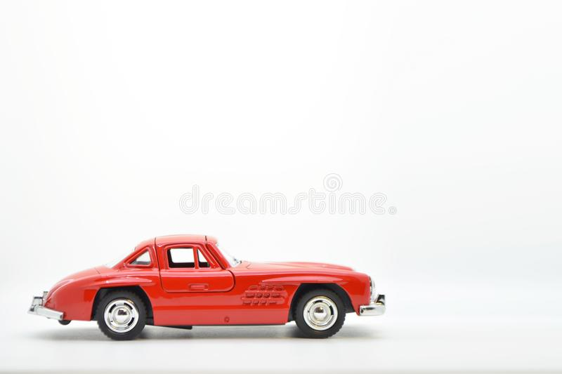 Red little ancient model toy car isolated on background. royalty free stock photo