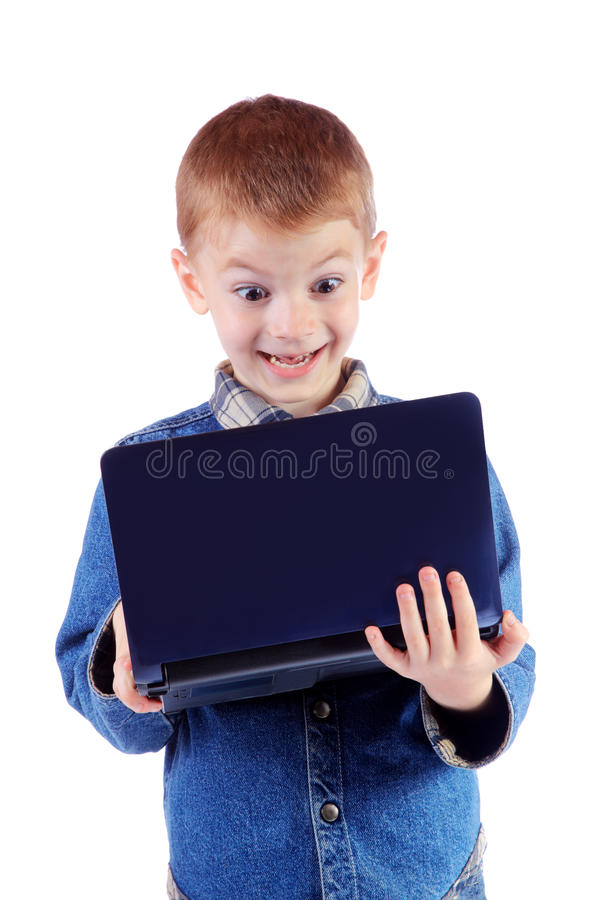 Red little boy with surprise looks in the laptop stock images