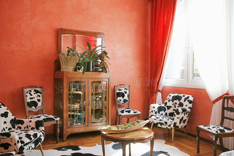 Red living room. An interior of the red living room with a dalmatians sofa stock photography