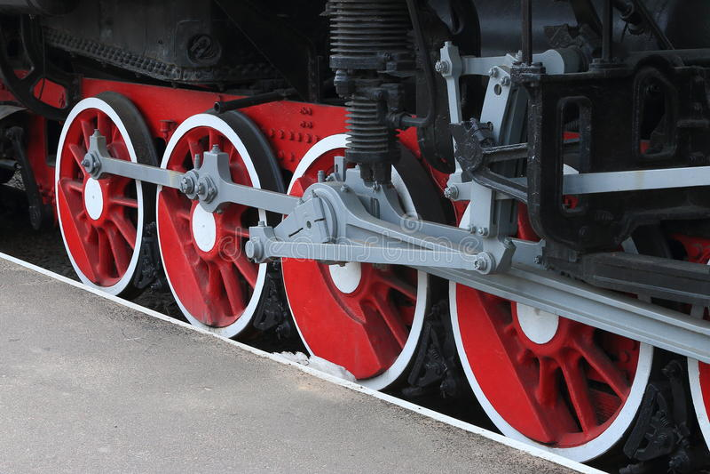 Red locomotive wheels. Close-up stock photos