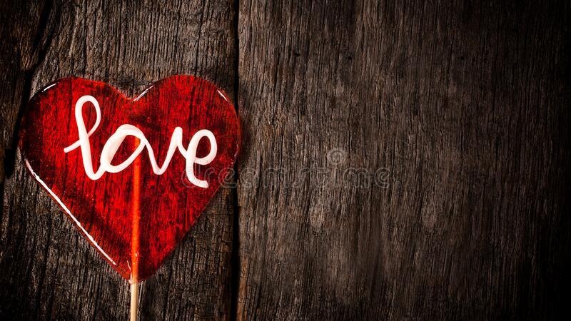 Red lollipop with word love stock images