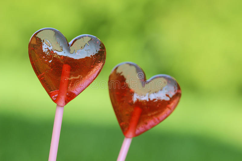 Red lollipops in heart shape royalty free stock images