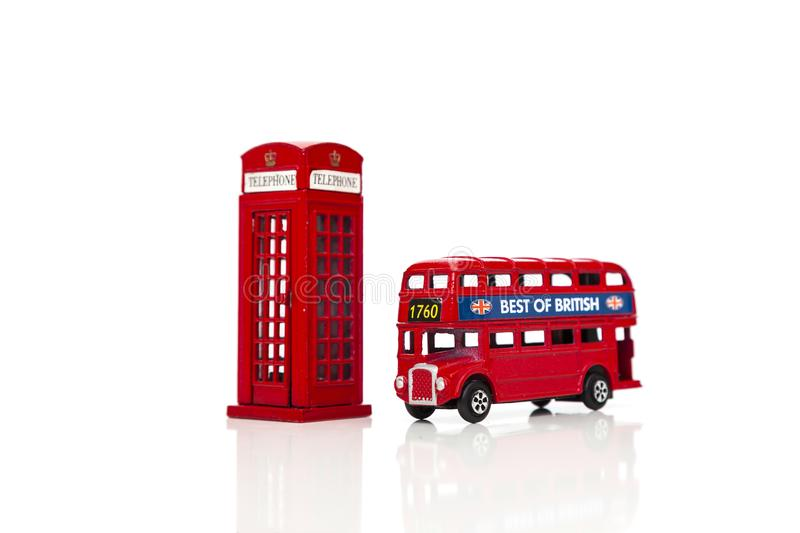 a red london doubledecker bus and red telephone box stock
