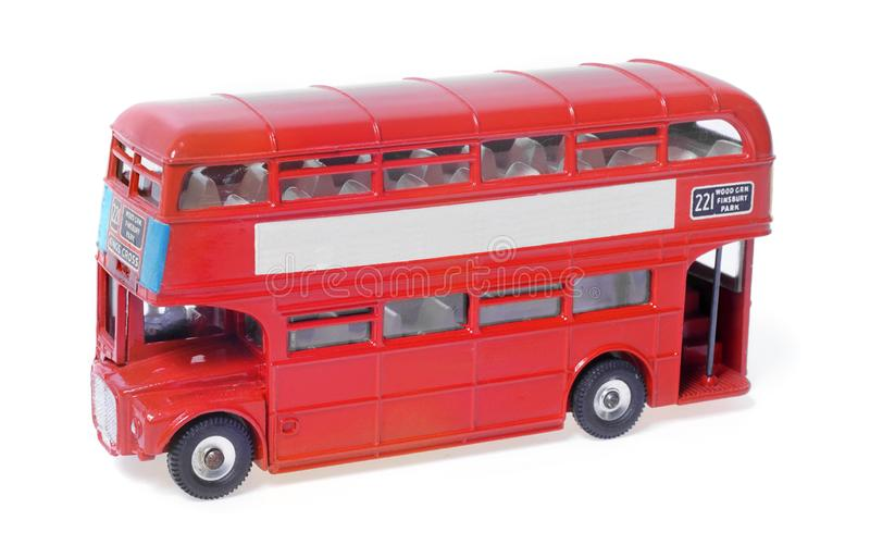 Red London Toy Model Bus. Routemaster model red London bus with destination information on a white background. Space on side for copy stock images