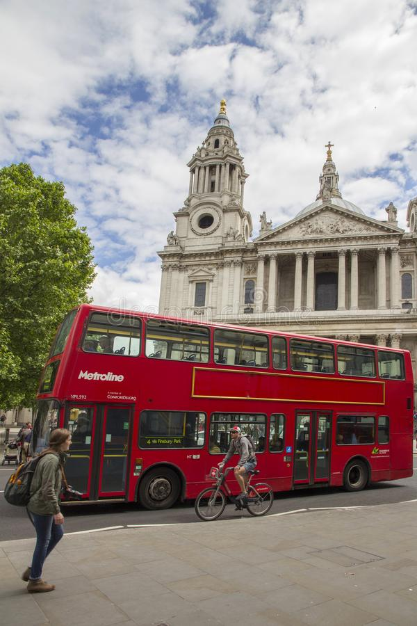 Red London Routemaster bus in front of St Pauls Cathedral, London, England, UK, May 20, 2017. LONDON, UK - MAY 20, 2017. Red London Routemaster bus in front of royalty free stock images