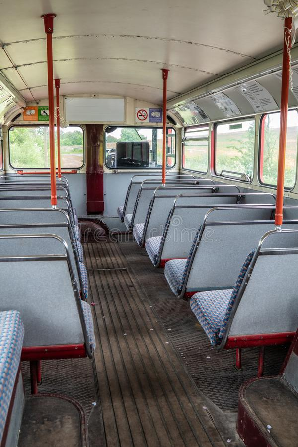 Red London Routemaster bus. No 14. Inside showing the group floor, downstairs seating area royalty free stock photo