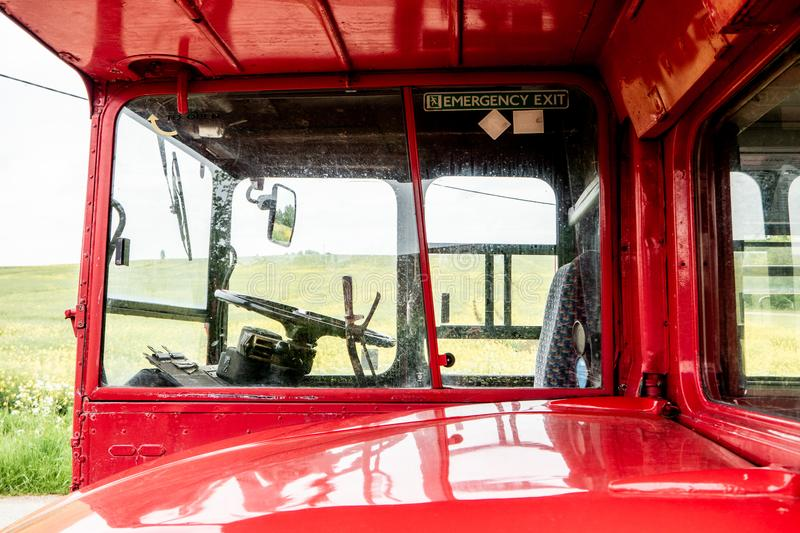Red London Routemaster bus. No 14. Viewed from the near side showing steering wheel and hand brake royalty free stock photos
