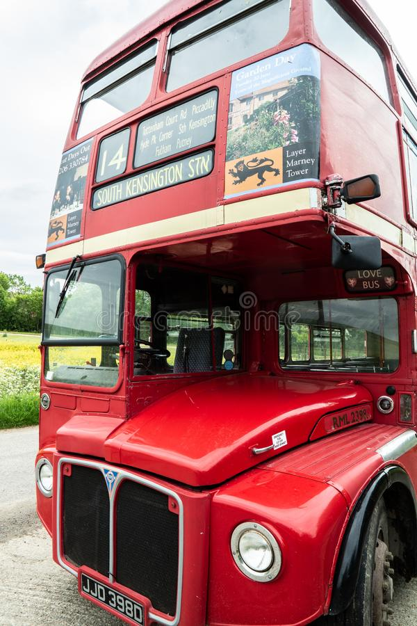 Red London Routemaster bus. No 14. Viewed from the front showing headlights and front grill, the destination board and number stock image