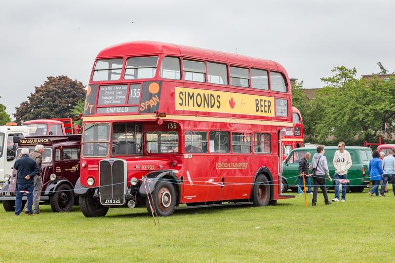 Red London routemaster double -decker bus. Enfield, London, UK - May 25 2014: Red London routemaster bus standing in a field on display royalty free stock photo
