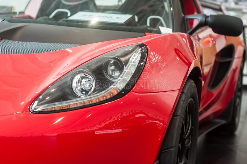 Red Lotus Elise front at retailer showroom. Mulhouse - France - 9 October 2019 - Closeup of red Lotus Elise front at retailer showroom stock photo
