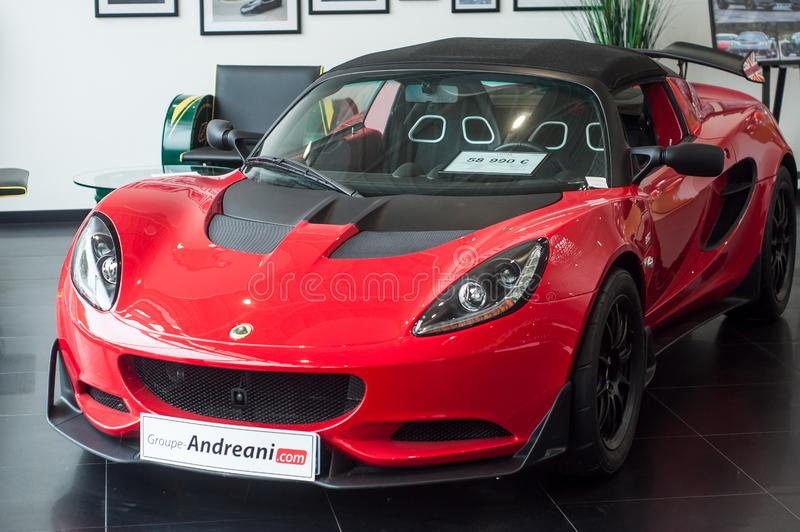 Red Lotus Elise front view at retailer showroom. Mulhouse - France - 9 October 2019 - Closeup of red Lotus Elise front view at retailer showroom stock image