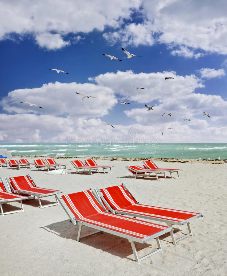 Download Red Lounge Chairs On A Tropical Beach Stock Photo - Image: 22472994