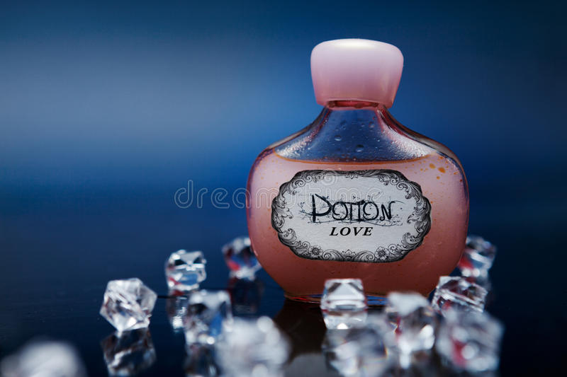 Red love potion in a bottle with crystals royalty free stock photos