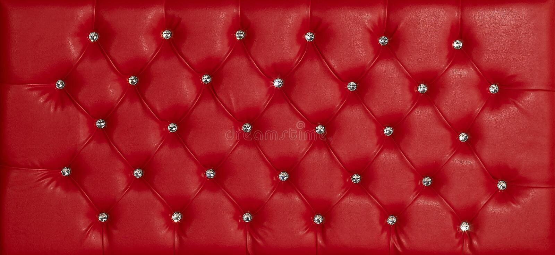 Red luxury leather diamond studded background stock photo