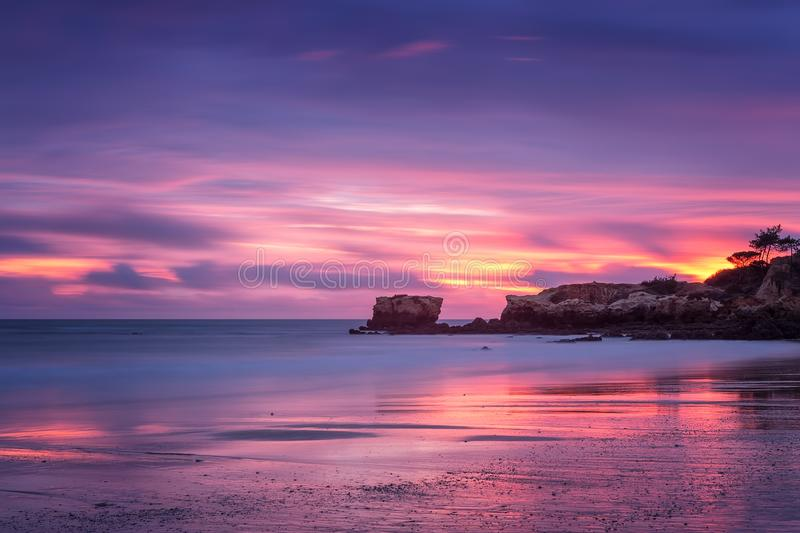 Red magic sunset on the beach of Oura in Albufeira. Portugal. Algarve royalty free stock photography
