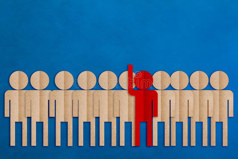 Red man paper cut raise hand among the others business leader co royalty free stock images