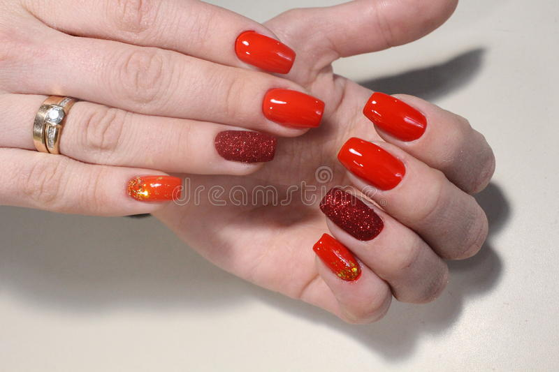Red manicure, velvet with sparkles stock photography