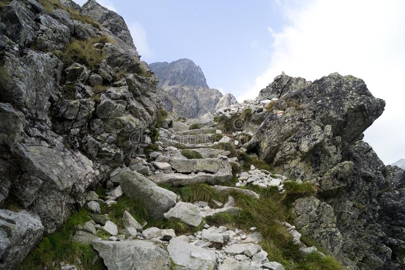 Red marked mountain trail in Tatra Mountains. Red marked mountain trail. Stone stairs in difficult rocky terrain. Tatra Mountains. Slovakia stock photo