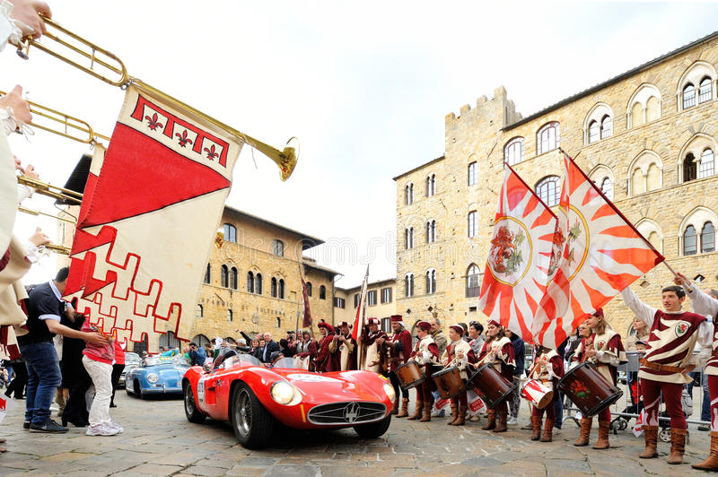 A red Maserati 300 S spider Fantuzzi, followed by a blue Porsche 356 Speedster, takes part to the 1000 Miglia classic car race. VOLTERRA (PI), ITALY - MAY 17: A stock image