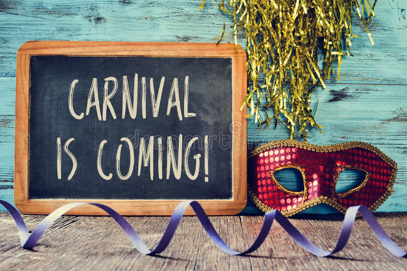 Red mask and text carnival is coming royalty free stock image