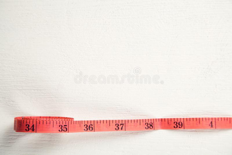 Red measure tape on white desk stock photos