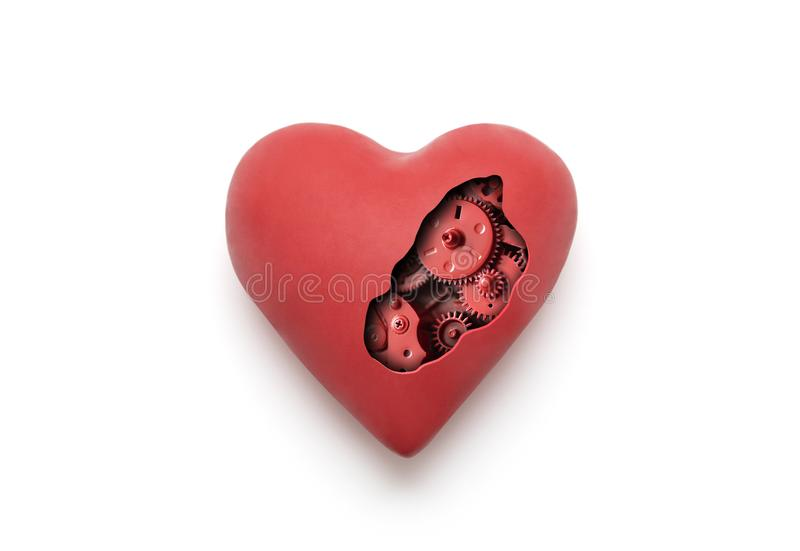 Red mechanical heart over white background. With clipping path royalty free stock image