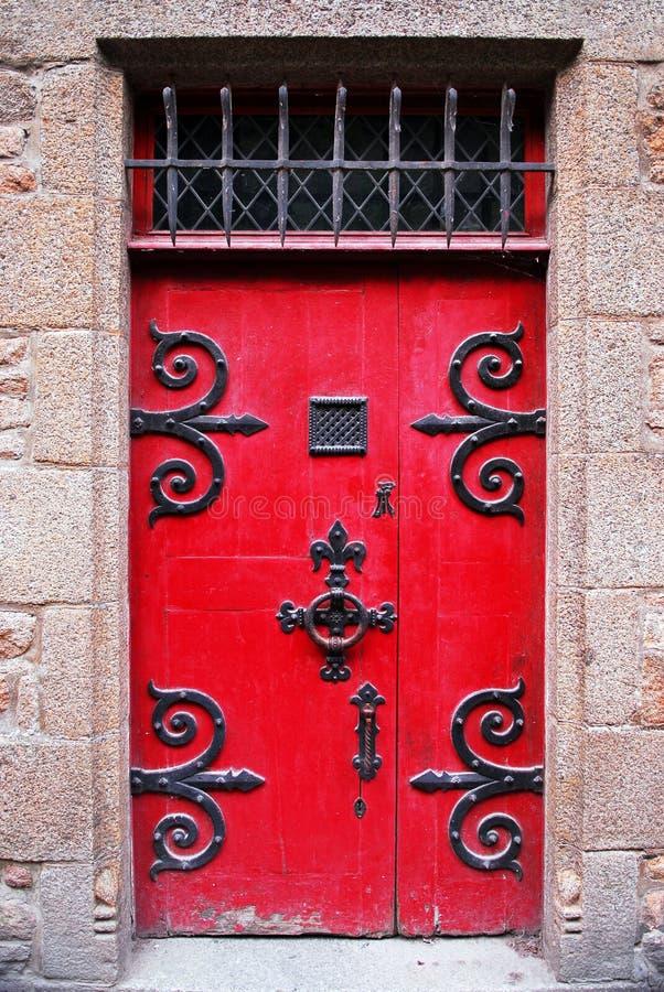 Red medieval door stock photography