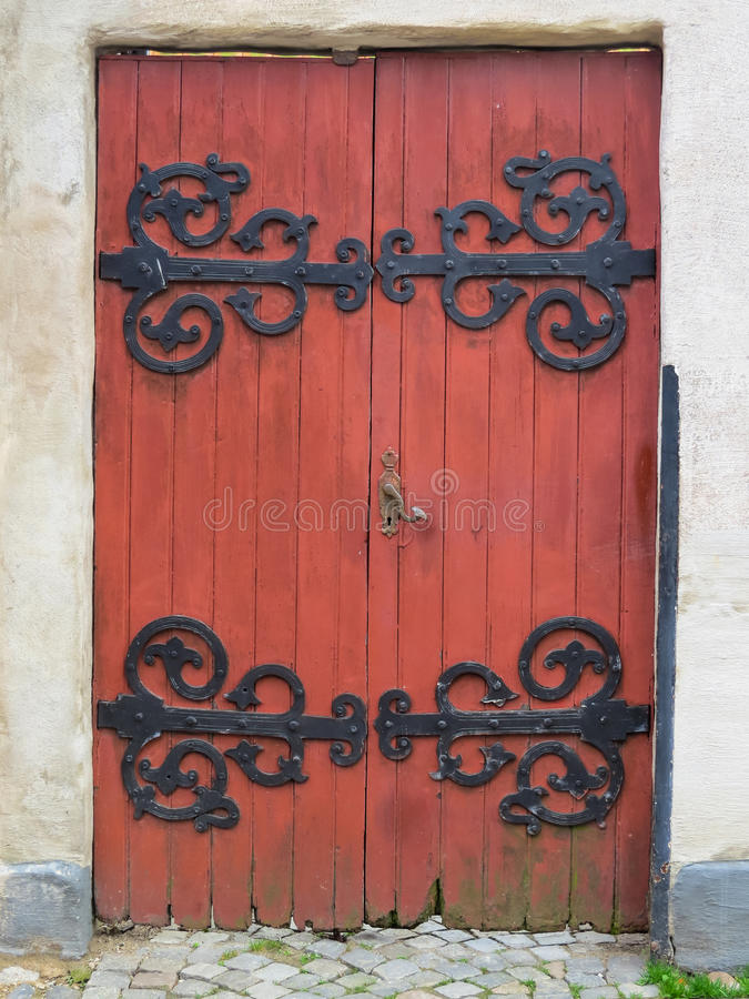 Red medieval wooden door royalty free stock images