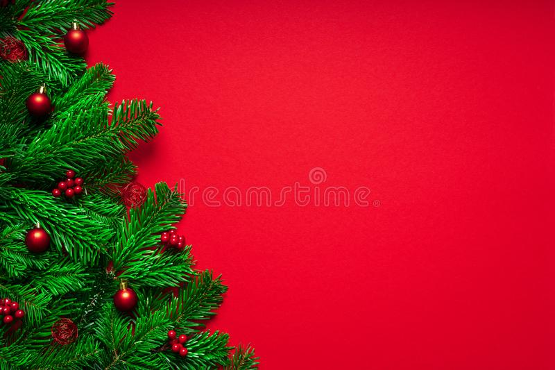 Red Merry Christmas Background with Fir branch an Baubles stock images