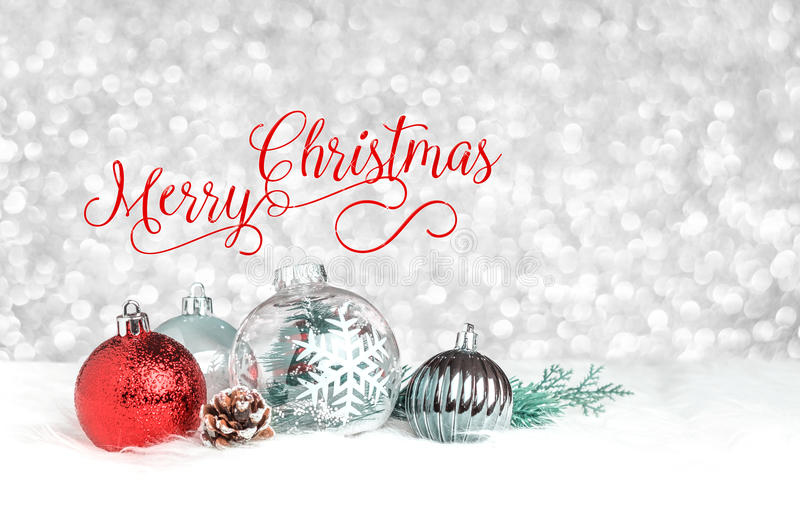 Red Merry Christmas over decoration ball on white fur at silver. Bokeh light background,Holiday greeting card royalty free stock photography