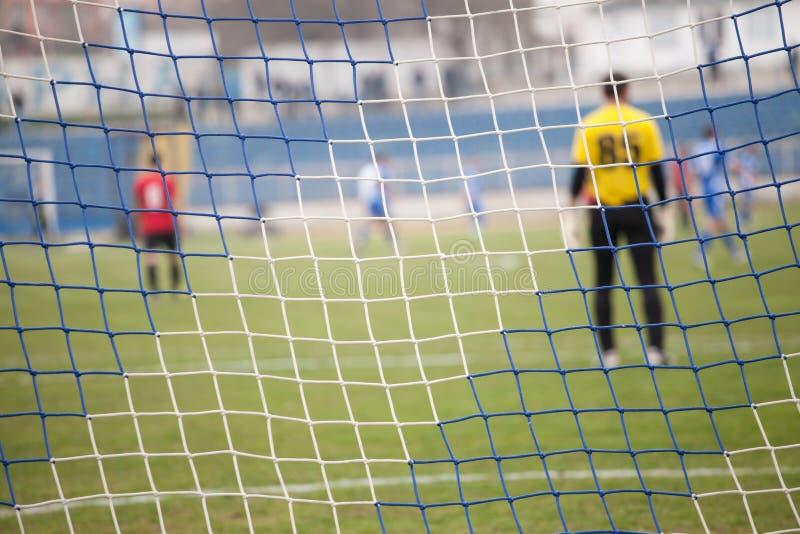 Red, meta del fútbol durante un mach del fútbol foto de archivo