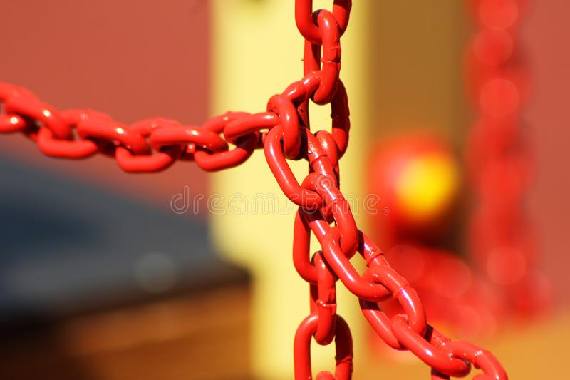 Red metal chain for protection royalty free stock images