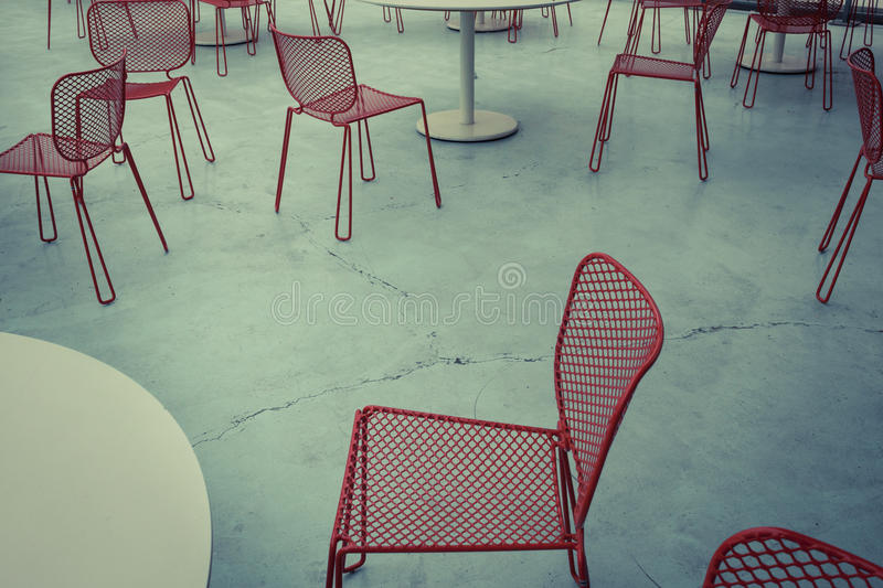 Red Metal Chairs On Concrete Floor Royalty Free Stock Photo
