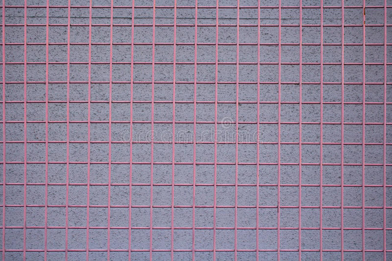 Red metal grid over stucco wall royalty free stock photos