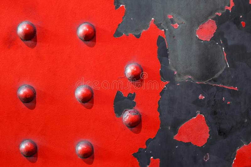 Red metal plate background - riveted industrial steel royalty free stock images