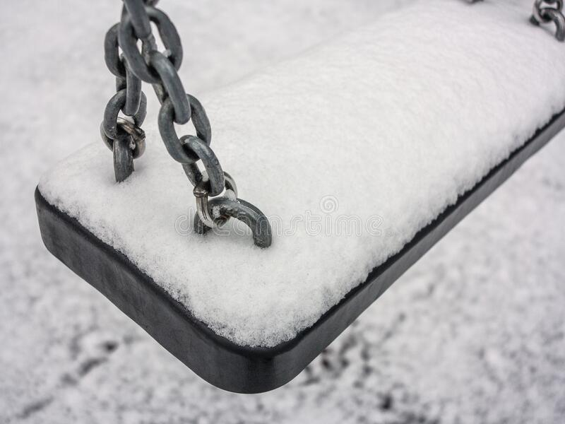 Snow-Covered swing royalty free stock photo