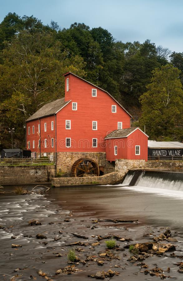 The Red Mill. The historic Red Mill in Clinton NJ with people fishing in the river. The village also decorated for halloween as photo taken in Mid October stock photo