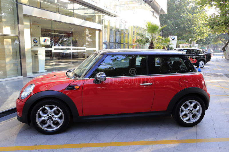 Red mini cooper in the morning royalty free stock photos
