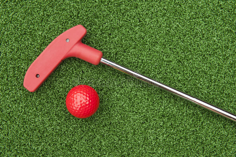 Red Mini Golf Putter and Ball royalty free stock photography