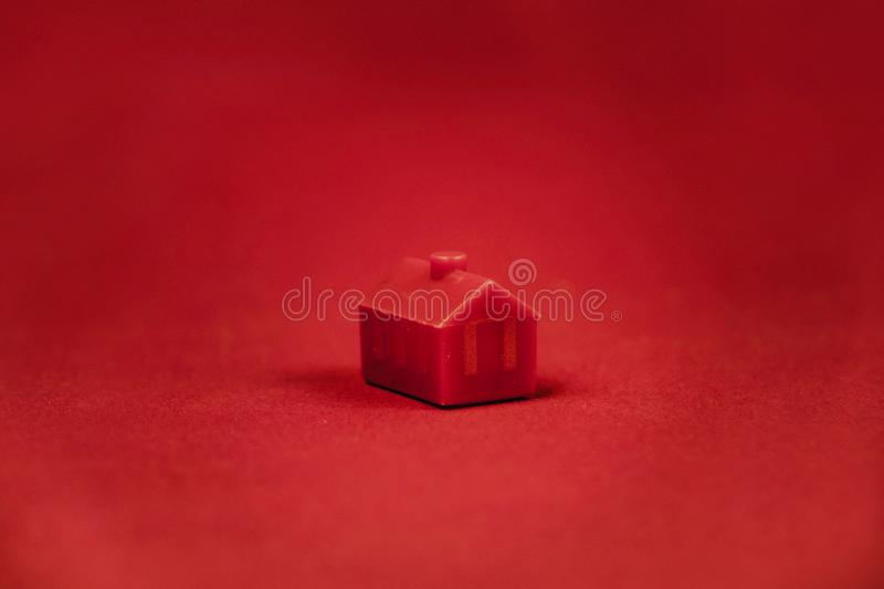red miniature house isolated on red background royalty free stock photos