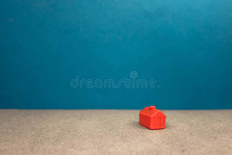 Red miniature house standing alone on a blue background, the concept of wealth, success. Model, successful, housing, luck, construction, business, car, design royalty free stock photos