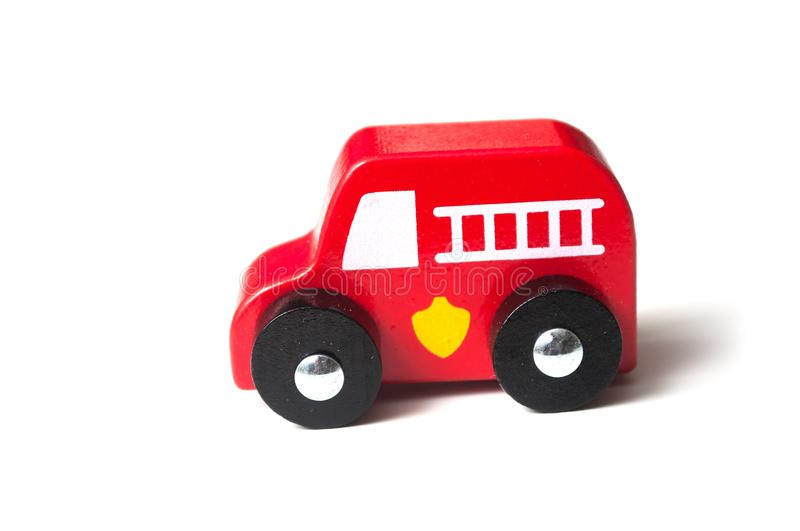red miniature wooden truck on white background - concept fire rescue stock photos