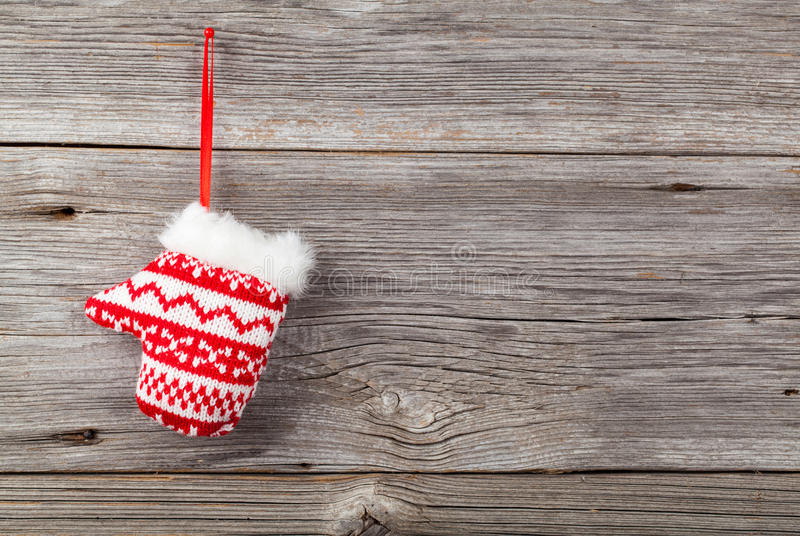 Red mitten. On wooden background royalty free stock photography
